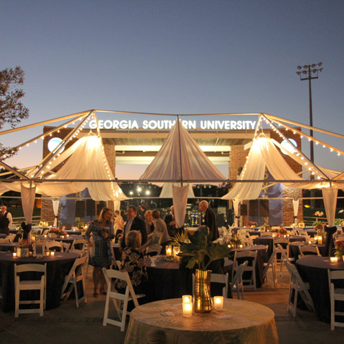 a mock tent in the 1900s style with a light up sign that says Georgia Southern University