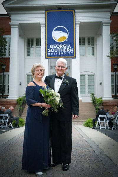 reunited couple standing in front of the Marvin Pittman building