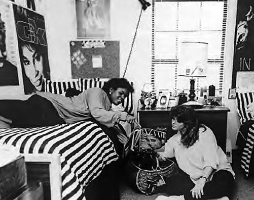 1980s photo of two women students sitting in their shared dorm room talking.