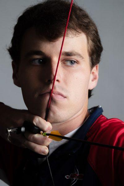 Adam Heidt pulling a bow back