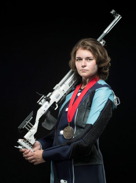 Rosemary Kramer holding a competition rifle
