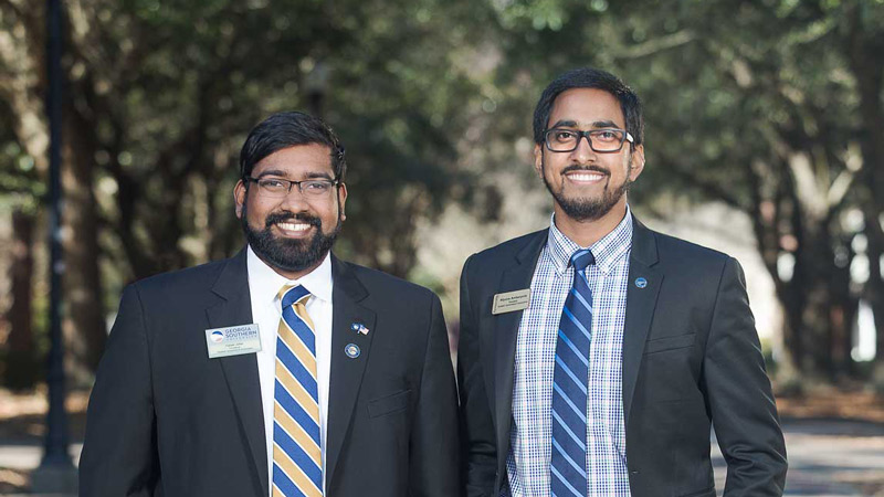 Dylan John and Nipuna Ambanpola standing side by side on the Statesboro campus