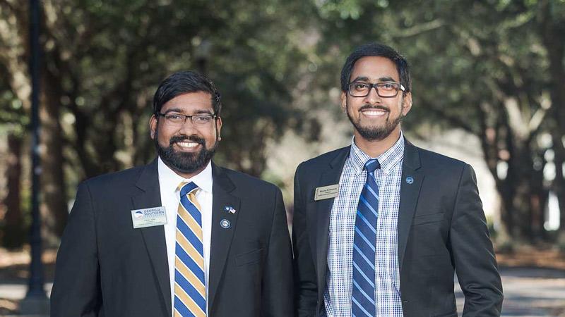 Dylan John and Nipuna Ambanpola standing side by side on the Statesboro campus