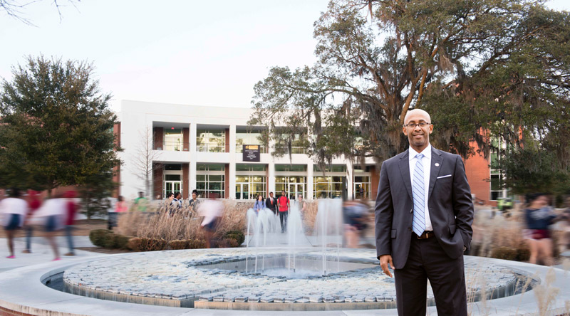 Georj Lewis standing in front of the Armstrong campus fountain