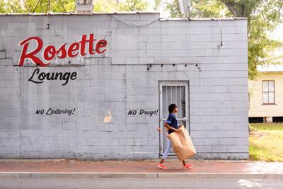 student walking past Rosette Lounge