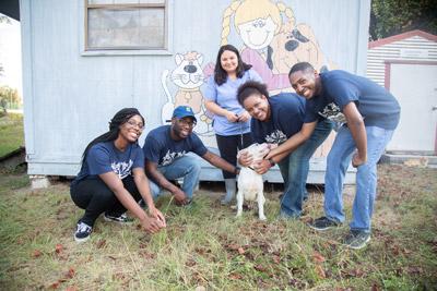 students donating at an animal shelter
