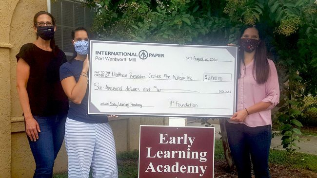From left to right, assistant professor of psychology Jennifer Wertalik, Ph.D., and ELA Director Ciarra Torres are presented a check by Kristie Meyers, communications coordinator for International Paper. The $6,000 grant will help fund the partnership between Georgia Southern and the ELA.
