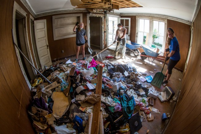 Students cleaning out abandoned house