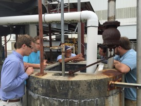 Darnell Wilson (center), Herty, explains the finer points of wastewater management to Georgia Southern engineering students during tour of effluent plant.  (left to right:  John West, Will Antonisse, Mr. Darnell Wilson, Zachariah Coles and Russ Spratlin)