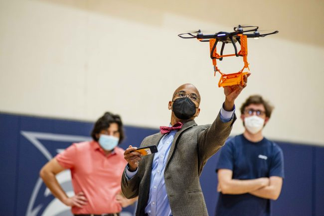 Wayne Johnson, Ph.D., examines a drone in preparation for the Engineering Design Challenge.