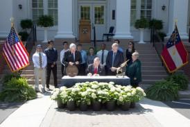Governor Nathan Deal signs legislation at Georgia Southern