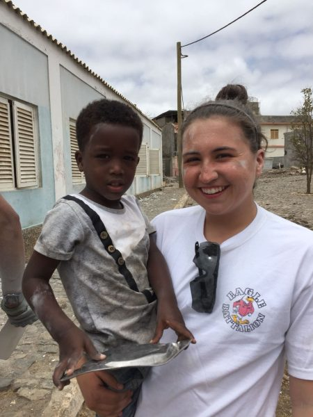Cantrall poses with a child during her trip to Africa.