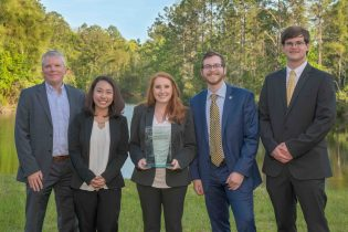 Jerry Burke (left), Ph.D., chair of the department of logistics and supply chain management, with the team who won the 2018 IANA UNF case competition.