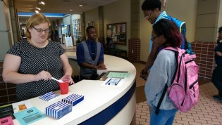 Nicole Withers, administrative coordinator for the Office of Alcohol & Other Drug Programs, prepares a non-alcoholic 'mocktail' for students as part of National Collegiate Alcohol Awareness Week (NCAW) held in Oct. The