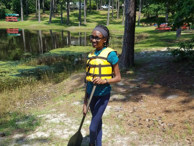 """Tolulope """"Tolu"""" Ojo, a biology graduate student at Georgia Southern University, poses for a photo at a camp she volunteers at. Tolu is hoping to get back to volunteering at the camp after the COVID-19 pandemic."""