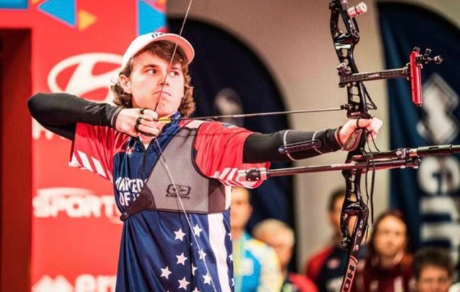 Adam Heidt shoots a bow during a competition