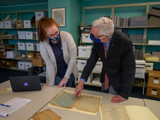 Autumn Johnson, special collections librarian at Zach S. Henderson Library, and Howard Keeley, Ph.D., examine documents in the Lawless papers collection. The documents are housed in the special collections section of the Henderson Library on the Statesboro Campus.