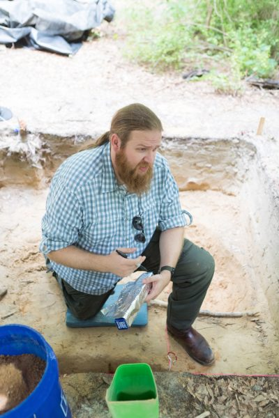 Assistant Professor of Anthropology, Ryan McNutt, Ph.D., works on an archeological project at Camp Lawton, a site in Jenkins County near the setting of the upcoming project.