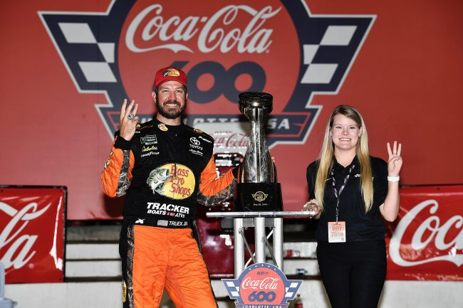 Megan Leben poses for a picture with NASCAR driver Martin Truex Jr. after his win at the Coca-Cola 600 at Charlotte Motor Speedway. Leben interned with Truex's team, Joe Gibbs Racing last summer.