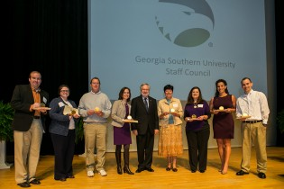 During the event, eight staff members were honored with Awards of Merit. From left:  Jeff Blythe, Sara Bailey, Michael Bochian (on behalf of Jesse Hopkins), Jaynie Gaskin, Dr. Brooks Keel, Valarie Kasay, Lynn Reaves, America Minc and Joshua Williams.