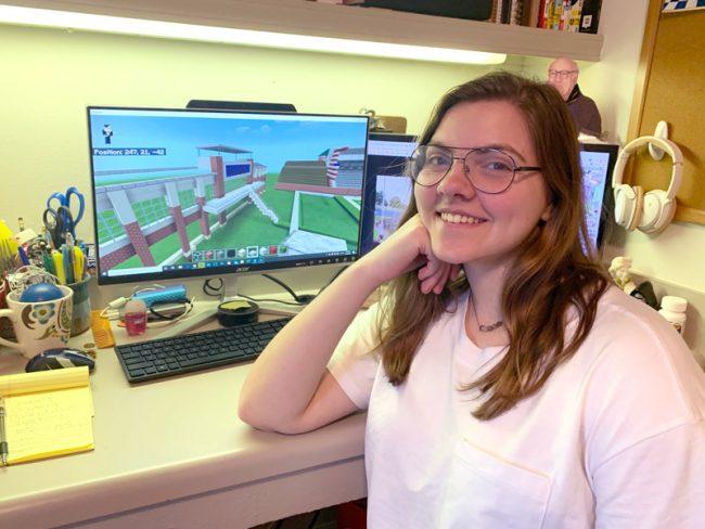 Rebecca Hooper building Paulson on her computer
