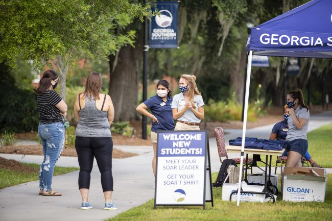 SOAR leaders pictured with new students as they welcome them on campus at Georgia Southern University.
